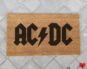 """""""AC/DC"""" mat"""