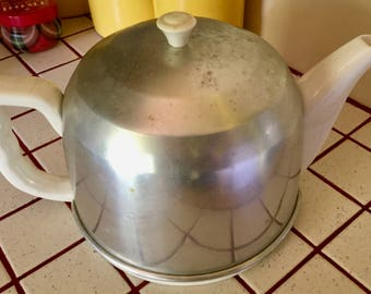 Teapot with aluminum insulated cover