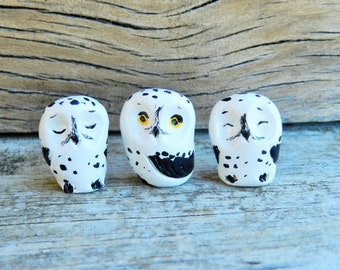 three tiny snowy owl figurines