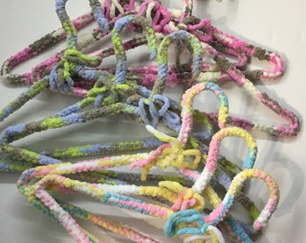 Nine covered hangers are hand made for baby's special garments; a very unique addition to any baby gift.