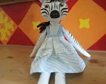 Zebra doll in dress blue and white ruffled