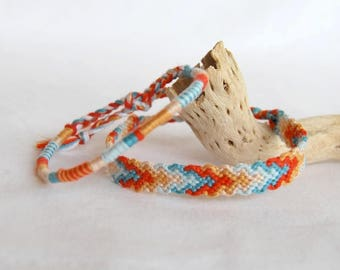 Matching orange blue friendship bracelets friendship bracelet bracelet atebas graphic hipster man woman Brasilda