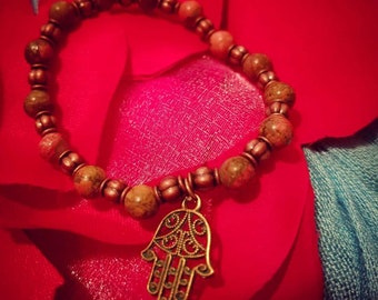 "Hamsa Hand beaded bracelet with metallic and semi precious stones. Model's wrist is a 6.5""."