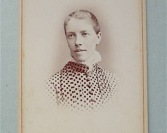 Cabinet Card, antique.  Featuring an amiable looking young lady.  T & J Holroyd, Esplanade House, Harrogate.  c1875.