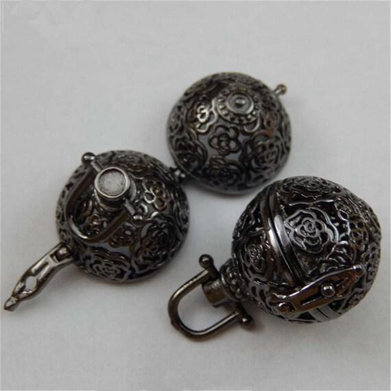 Filigree Black Metal Glow Pendant, LED light inside black filigree pendant, glowing pendant, lighted pendant. firefly light pendant