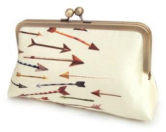 Yellow arrows clutch bag, silk purse, red arrow