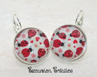 Earrings sleepers cabochons 20 mm hearts and ladybugs red beige striped supports toned silver background