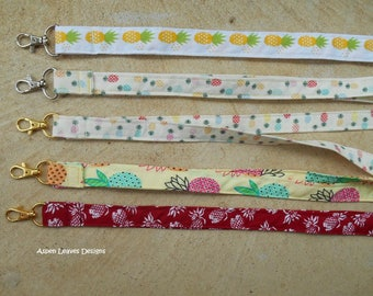 Pineapple lanyards plus charms. Five trendy style pineapple lanyards for keys and badges.