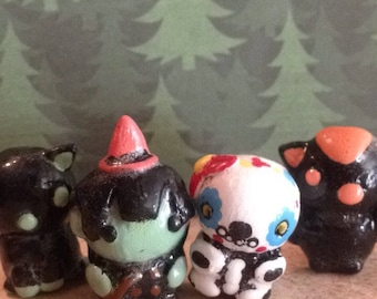 Halloween edition cat witch bat and skeleton figurines