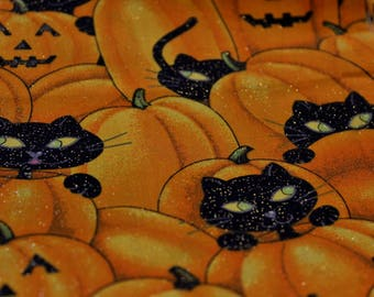 """Sparkle on Black cats in Pumpkins Jack o Lanterns  44-45"""" wide 100% cotton by Fabric Traditions"""