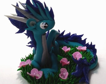 Blue flame dragon with pink flowers