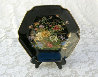 Japanese Kutani Black Floral Plate, hand-decorated in gold, flowers, birds, butterflies, wood stand