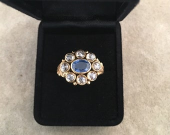 A hand-made 18ct gold ring set with a natural sapphire and rose-cut diamonds