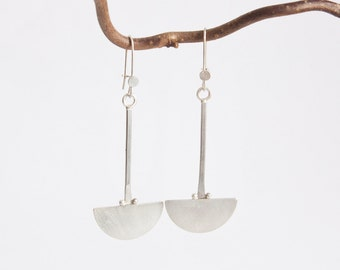 Extra long silver earrings, half circles made into a very tribal and modern design!