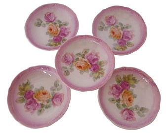 "Set of 5 pink and floral dessert/berry  bowls. Maker's mark reads ""Germany."""