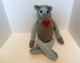 Handmade repurposed sweater monster in green, turquoise and soft teal. Stuffed monster.