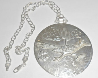 Cool large vintage Southwestern Bell nickel silver roadrunner cactus desert scene round medallion pendant on a sterling silver neck chain