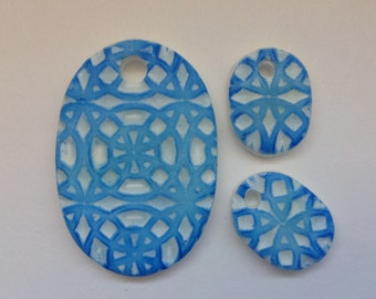Vibrant blue embossed oval component set