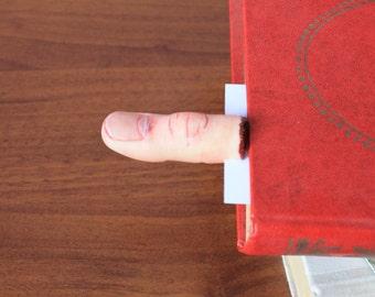 Finger bookmarker. Severed finger. Horror.