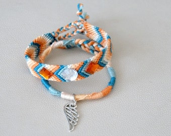 Brazilian and spiral bracelets duo blue and orange cabochons wing Brasilda Wing charm