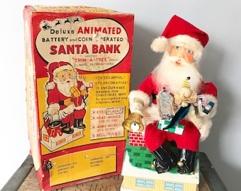 1960 Vintage Trim A Tree Deluxe Animated Battery and Coin Operated Santa Bank by Noel Decorations Inc. Comes with Original Box