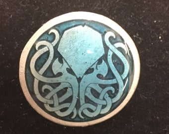 Elegant Aged Pewter Cthulhu pin with translucent pale blue resin top fill