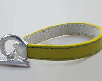 Women bracelet leather yellow silver plated clasp, White leather lining, lagoon blue stitching.