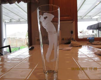 Golfer swinging on pilsner glass