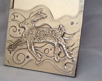 Mirror with hare design.