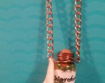 Chloroform bottle and rag necklace
