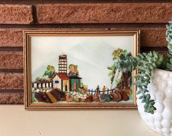 Vintage Framed Home & Dwellers Sand with Stones Art