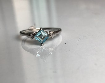 Natural square shape blue topaz ring with natural zircon in 925 sterling silver