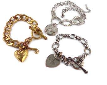 3 Juicy Couture Bracelets/  Juicy Lady Rhinestone Horseshoe Charm Bracelet  / Gold tone Puff HEART Toggle Bracelet