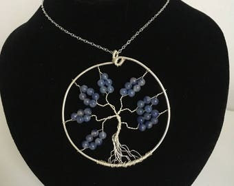 Tree of life pendant made using blue beads