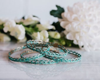 Vintage Lace bangle bracelet cast in bronze with turquoise patina