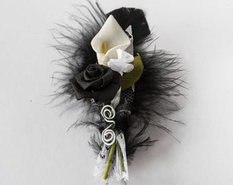 Black feather groom boutonniere cala pink black and white