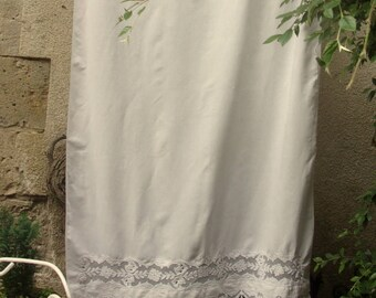 Antique curtain with embroidery and applications