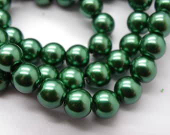 50 8 mm mother of Pearl 8 mm green glass beads