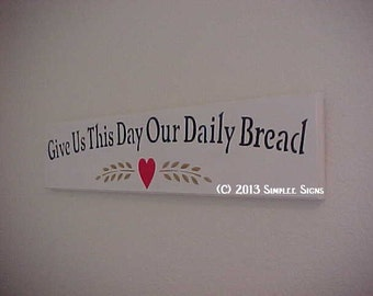 Give Us This Day Our Daily Bread, with golden wheat and a red heart.