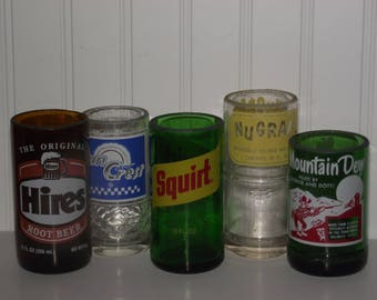 A vintage collection of soda bottles, cut to size & ready to use as pop, juice, milk or water glasses