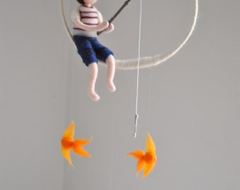 Fishing boy Waldorf inspired needle felted doll mobile: Boy with three orange fishes