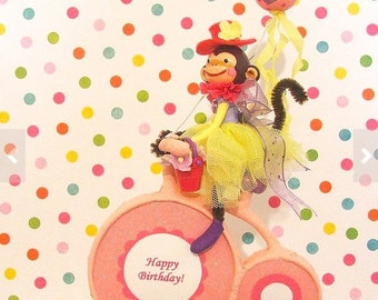 Bike Riding Girl Monkey in Purple, Pink, Yellow Cake Topper