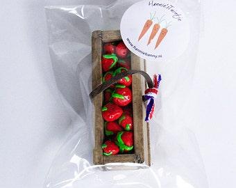 Miniature fruits in wooden basket