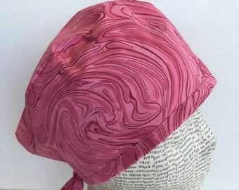 Men's Scrub Cap scrub hat featuring a dark pink swirl material