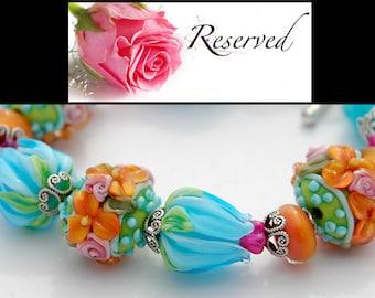 ReSeRvEd - Aqua Orange Flowers Lampwork Bracelet, Wildflowers Lampwork Beads, Tulips, Blue, Green, Pink