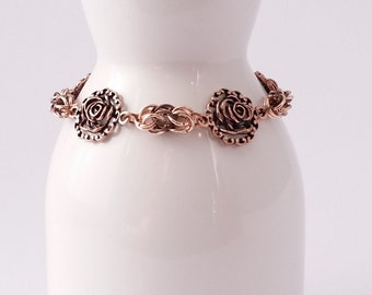 Coppery rosette and byzantine chain maille bracelet with a keeper chain and toggle clasp