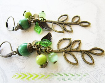 Earrings bronze leaf charms green beads and leaves
