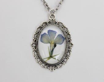 Blue pressed flower necklace