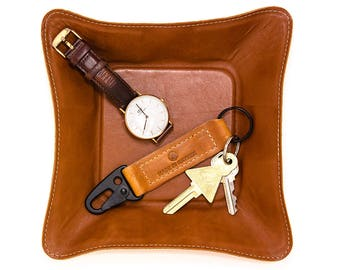 Tan leather catch-all tray, made in Los Angeles with suede backer. Packs flat for travelling, a great tray for keys, change and jewelry.