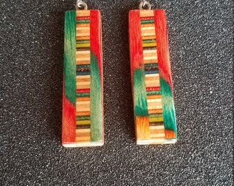 Dangle earings made from recycled skateboards